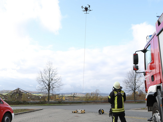 Firefighter operating an UAV powered by a TGS Avior