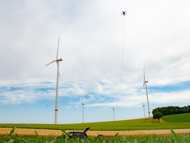 A tethered drone is operated in a windpark